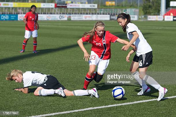 Susanne Haaland of Norway challenged by Vildan Kardesler of Germany during the Girls Friendly match between Norway U16 and Germany U16 at the UKI...