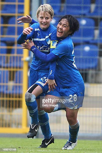 Susanne Hartel and Mana Iwabuchi of Hoffenheim celebrate their team's second goal during the Women's Second Bundesliga match between TSG 1899...