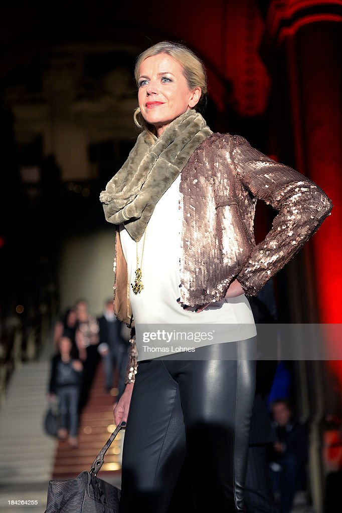 Susanne Sigl presents 'Minx' fashon during the celebrity fashion at the Minx fashion night at Residenz on October 12, 2013 in Wuerzburg, Germany. The benefit of the charity gala is for the aid organisation 'Sauti Kuu' of Auma Obama. Behind the fashion label Minx stands Eva Lutz.