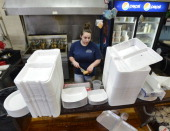 Susan's Fish N Chips in Portland uses Styrofoam takeout containers and will comply with Portland's new ban Manager Lindsey Schwarz is framed by the...