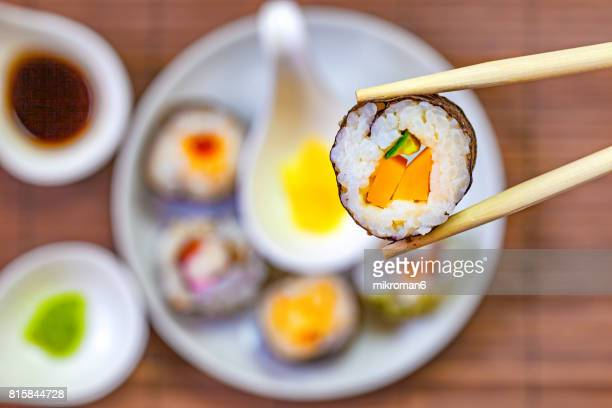 Sushi and chopsticks on a wooden mat