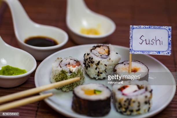 Sushi and chopsticks on a wooden mat