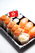 Sushi food on tray with Hong Kong flag against white background