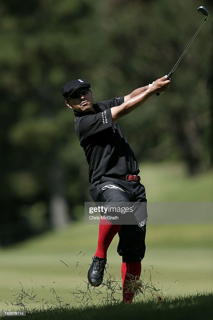Sushi Ishigaki of Japan plays his second shot on the fourth hole during day three of the Panasonic Japan Open at Ibaraki Golf Club on September 28, 2013 in Ibaraki, Japan.