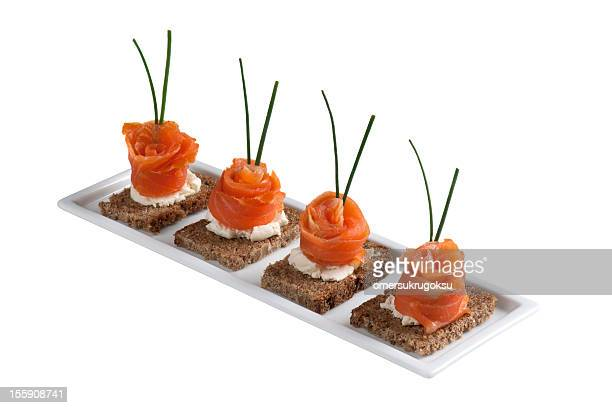 Sushi made with salmon placed on bread on a plate