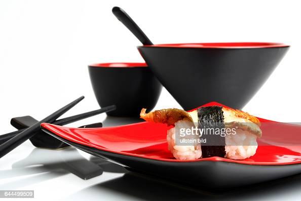 sushi mit geschirr pictures getty images. Black Bedroom Furniture Sets. Home Design Ideas