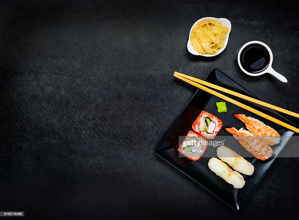 Sushi on Dark Plate with Copy Space : Stock-Foto