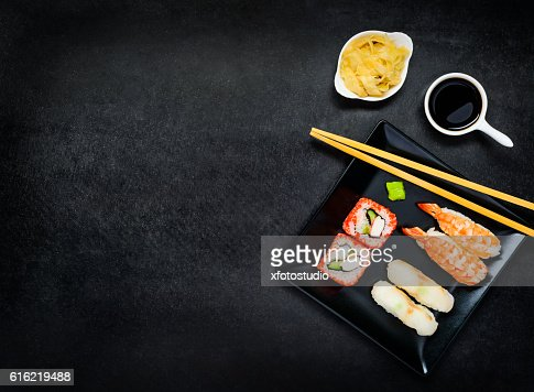 Sushi on Dark Plate with Copy Space : Stock Photo