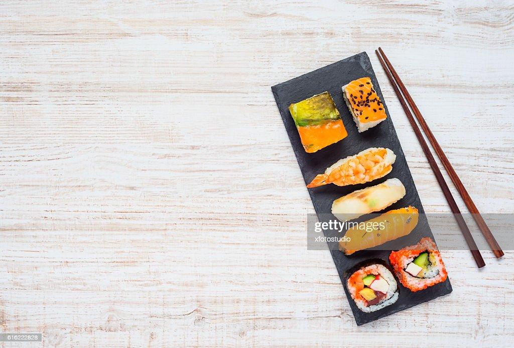 Sushi on Plate with Chopsticks and Copy Space Area : Stockfoto