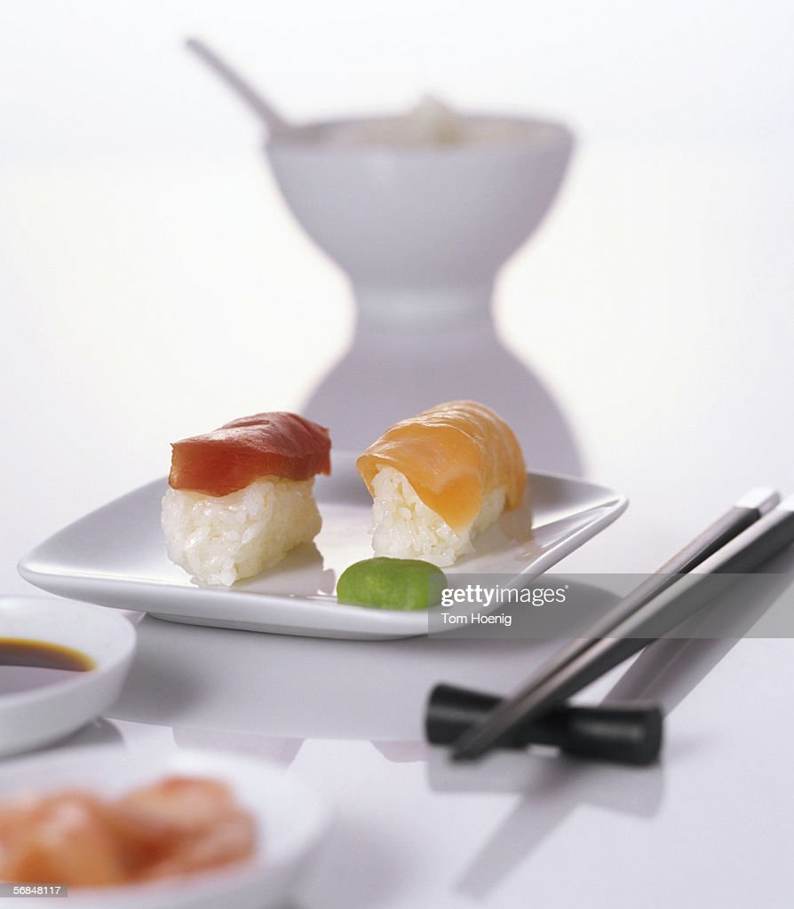 Sushi on plate with chopsticks : Stock Photo