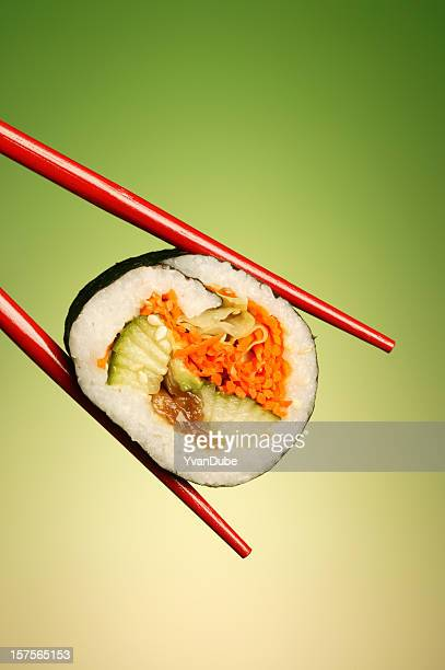 sushi roll in red chopstick
