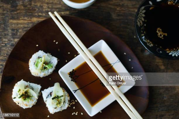 Sushi, sauce and chopsticks on tray