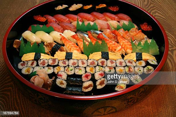 Sushi Set A giant lacquerware plate of sushi which can be ordered from sushi shops across Japan to dine in or have it delivered in minutes to your...
