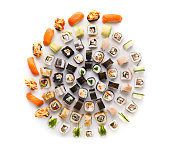 Big party sushi set isolated on white background. Japanese food delivery and take away. Fish and vegetable rolls, salmon nigiri and spicy gunkans, top view