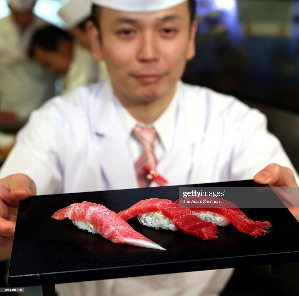 A sushi shef serves tuna sushi dish made from the 222-kilogram bluefin tuna, that was auctioned at 155.4 million Japanese yen (approximately 1.8 million U.S. Dollars) at the opening day of Tsukiji Wholesale Fish Market on January 5, 2013 in Tokyo, Japan. The price was as triple as last year's 56.5 million yen.