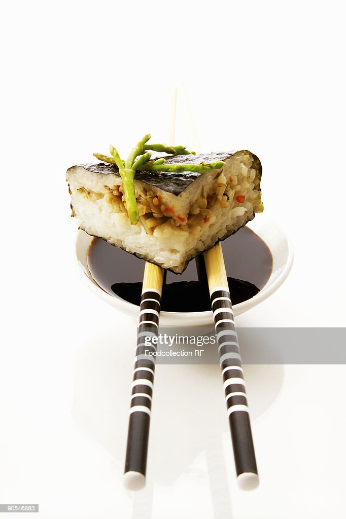 Sushi with soy sauce and chopsticks, close up : Stock Photo