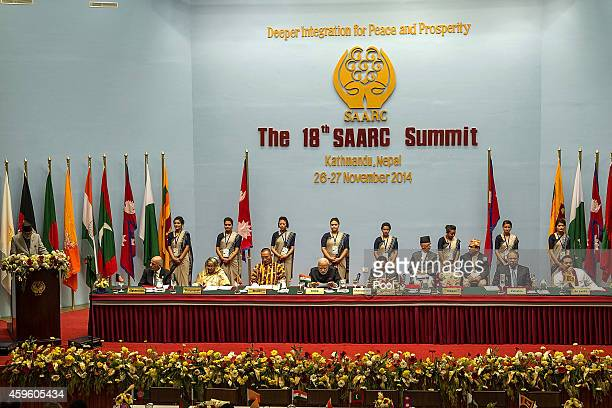 Sushil Koirala Prime Minister of Nepal gives a speech while other SAARC leaders sit during the inaugural session of the 18th SAARC Summit on November...