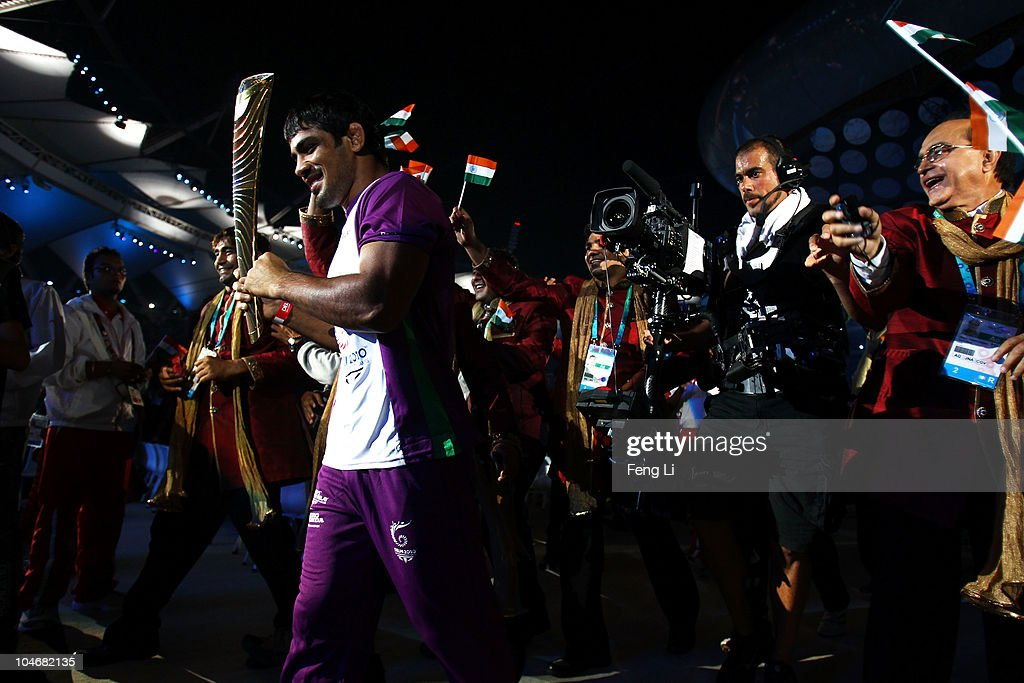 <a gi-track='captionPersonalityLinkClicked' href=/galleries/search?phrase=Sushil+Kumar&family=editorial&specificpeople=703954 ng-click='$event.stopPropagation()'>Sushil Kumar</a> of India carries the Queen's baton during the Opening Ceremony for the Delhi 2010 Commonwealth Games at Jawaharlal Nehru Stadium on October 3, 2010 in Delhi, India.