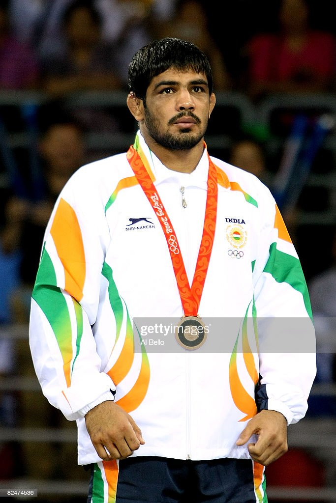 <a gi-track='captionPersonalityLinkClicked' href=/galleries/search?phrase=Sushil+Kumar+-+Wrestler&family=editorial&specificpeople=703954 ng-click='$event.stopPropagation()'>Sushil Kumar</a> of India celebrates his bronze medal in the 66kg Men's Freestyle wrestling at the China Agriculture University Gymnasium during Day 12 of the Beijing 2008 Olympic Games on August 20, 2008 in Beijing, China.
