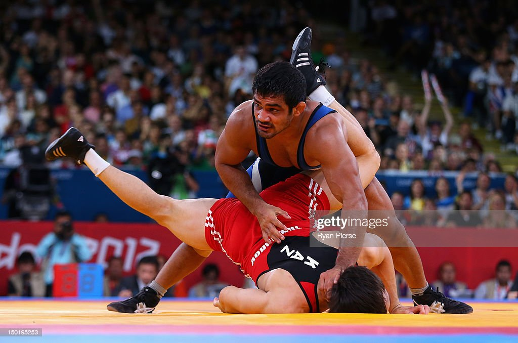 <a gi-track='captionPersonalityLinkClicked' href=/galleries/search?phrase=Sushil+Kumar&family=editorial&specificpeople=703954 ng-click='$event.stopPropagation()'>Sushil Kumar</a> of India in action against Akzhurek Tanatarov of Kazakhstan during the Men's Freestyle Wrestling 66kg semi final match on Day 16 of the London 2012 Olympic Games at ExCeL on August 12, 2012 in London, England.