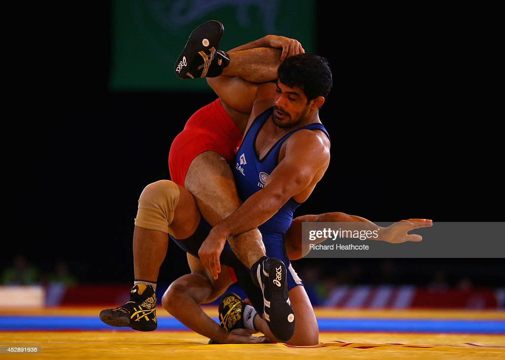 <a gi-track='captionPersonalityLinkClicked' href=/galleries/search?phrase=Sushil+Kumar+-+Wrestler&family=editorial&specificpeople=703954 ng-click='$event.stopPropagation()'>Sushil Kumar</a> of India (blue) on his way to beating Qamar Abbas of Pakistan in the 74kg Freestyle Wrestling Gold medal match at Scottish Exhibition And Conference Centre during day six of the Glasgow 2014 Commonwealth Games on July 29, 2014 in Glasgow, United Kingdom.