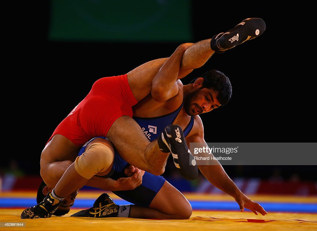 <a gi-track='captionPersonalityLinkClicked' href=/galleries/search?phrase=Sushil+Kumar&family=editorial&specificpeople=703954 ng-click='$event.stopPropagation()'>Sushil Kumar</a> of India (blue) on his way to beating Qamar Abbas of Pakistan in the 74kg Freestyle Wrestling Gold medal match at Scottish Exhibition And Conference Centre during day six of the Glasgow 2014 Commonwealth Games on July 29, 2014 in Glasgow, United Kingdom.