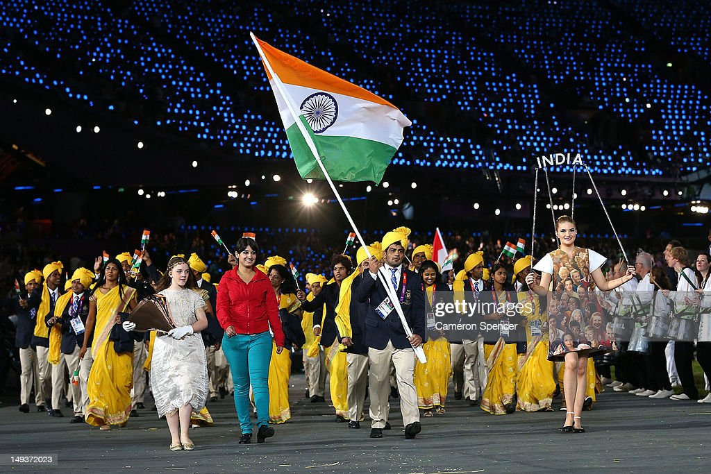 <a gi-track='captionPersonalityLinkClicked' href=/galleries/search?phrase=Sushil+Kumar&family=editorial&specificpeople=703954 ng-click='$event.stopPropagation()'>Sushil Kumar</a> of the India Olympic wrestling team carries his country's flag during the Opening Ceremony of the London 2012 Olympic Games at the Olympic Stadium on July 27, 2012 in London, England.