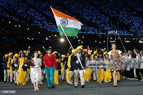 Sushil Kumar of the India Olympic wrestling team carries his country's flag during the Opening Ceremony of the London 2012 Olympic Games at the...