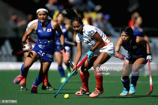 Sushila Pukhrambam of India attempts to take the ball away from Motomi Kawamura of Japan and Akiko Kato of Japan during the 5th8th Place playoff...