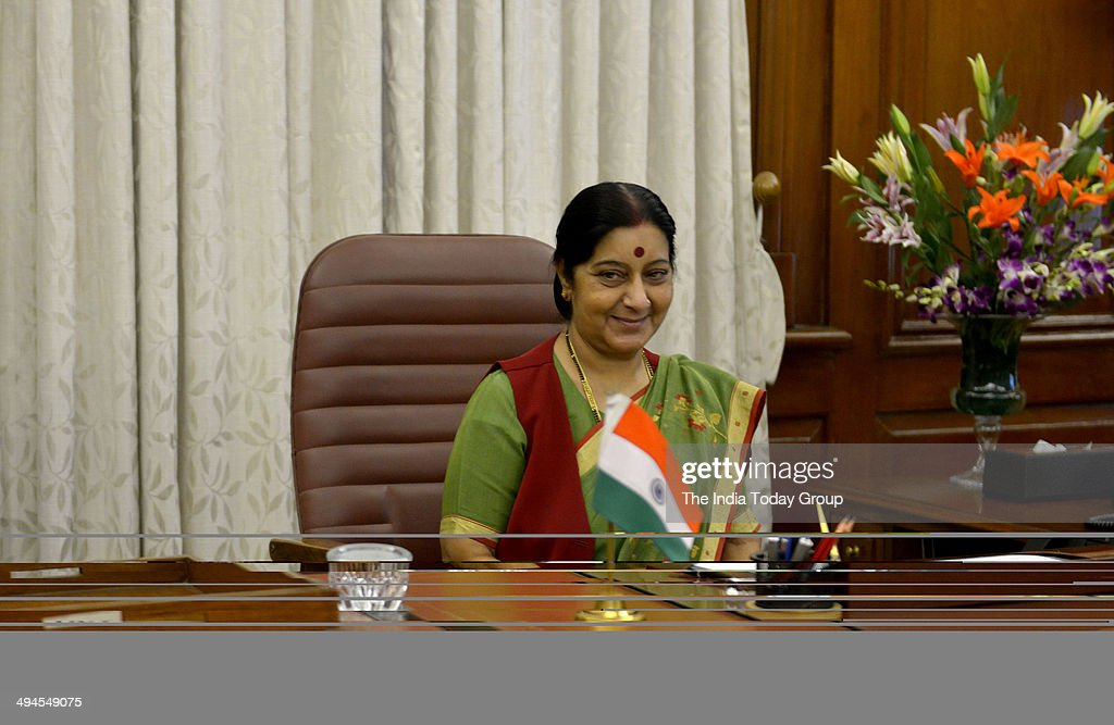<a gi-track='captionPersonalityLinkClicked' href=/galleries/search?phrase=Sushma+Swaraj&family=editorial&specificpeople=2147656 ng-click='$event.stopPropagation()'>Sushma Swaraj</a>, External Affairs and Overseas Indian Affairs Minister takes charge in her office on May 28, 2014 at South Block, New Delhi, India.