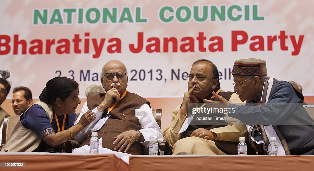 Sushma Swaraj talking with Senior party leaders L K Advani, Arun Jaitley and Murli Manohar Joshi during Bharatiya Janata Party National Council meeting at Talkatora Indoor Stadium on March 2, 2013 in New Delhi, India. In his 90 minute presidential address Rajnath Singh asked the party ranks to be prepared for early Lok Sabha polls and crucial assembly elections this year, including in Karnataka, Madhya Pradesh, Chhattisgarh, Rajasthan and Delhi all very important states for BJP.