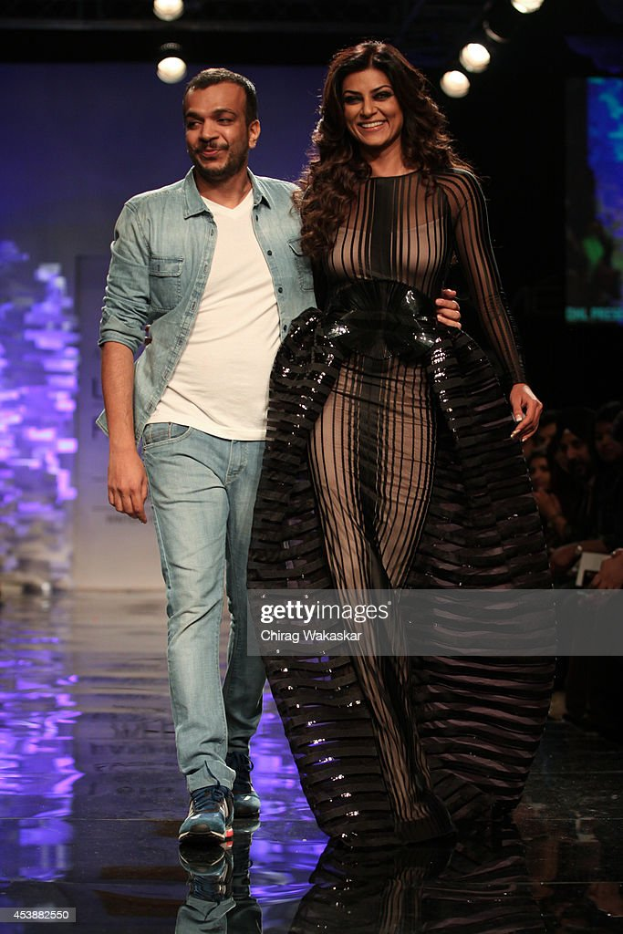 Sushmita Sen walks the runway with Amit Aggarwal during the Opening Day show as part of Lakme Fashion Week Winter/Festive 2014 at The Palladium Hotel...