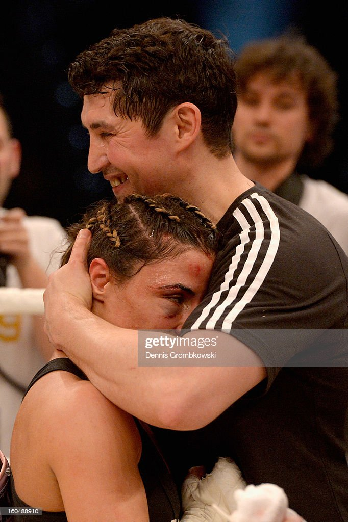 Susi Kentikian of Germany celebrates with coach Magomed Schaburow after winning her WBA Flyweight World Championship fight against Sanae Jah of Belgium at ISS Dome on February 1, 2013 in Duesseldorf, Germany.