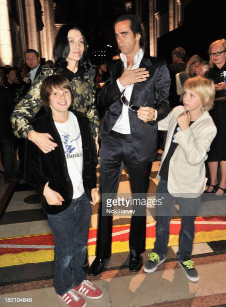 Susie Bick and Nick Cave with their children Earl and Arthur attends the front row for the Philip Treacy show on day 3 of London Fashion Week...