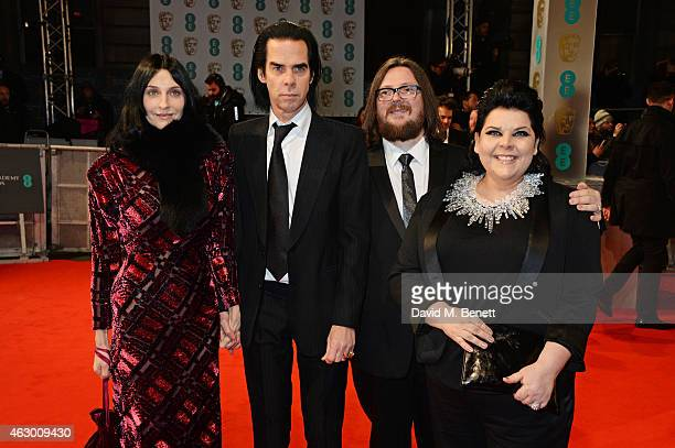 Susie Bick Nick Cave Iain Forsyth and Jane Pollard attend the EE British Academy Film Awards at The Royal Opera House on February 8 2015 in London...
