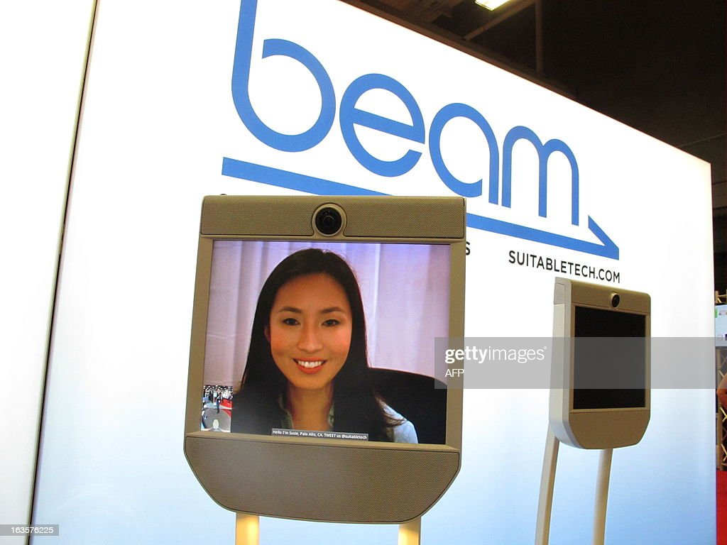 Susie Kim appears on a Beam robot video conferencing device from California at the South by Southwest (SXSW) interactive trade show on March 12, 2013. The device, in production since November and popular among SXSW attendees, marries an Internet video conferencing screen atop a pedestal with motorized base that can twist and turn on command from the user appearing on the screen. AFP PHOTO/Robert MacPherson