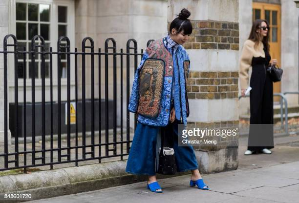 Susie Lau wearing flared cropped denim jeans outside Anya Hindmarch during London Fashion Week September 2017 on September 17 2017 in London England