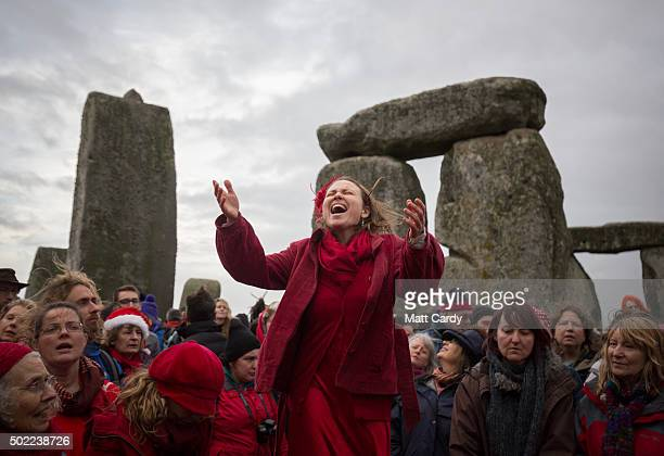 Susie Ro Prater leads the Shakti Sings choir as druids pagans and revellers gather in the centre of Stonehenge hoping to see the sun rise as they...