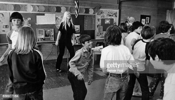 Susie Shimkus showing kids disco dancing Credit Denver Post