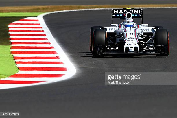 Susie Wolff of Great Britain and Williams drives during practice for the Formula One Grand Prix of Great Britain at Silverstone Circuit on July 3...