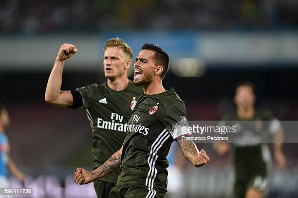 Suso and Ignazio Abate of AC Milan celebrate a goal 22 scored by Suso during the Serie A match between SSC Napoli and AC Milan at Stadio San Paolo on...