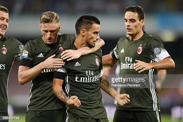 Suso Ignazio Abate and Giacomo Bonaventura of AC Milani celebrate a goal 22 scored by Suso during the Serie A match between SSC Napoli and AC Milan...