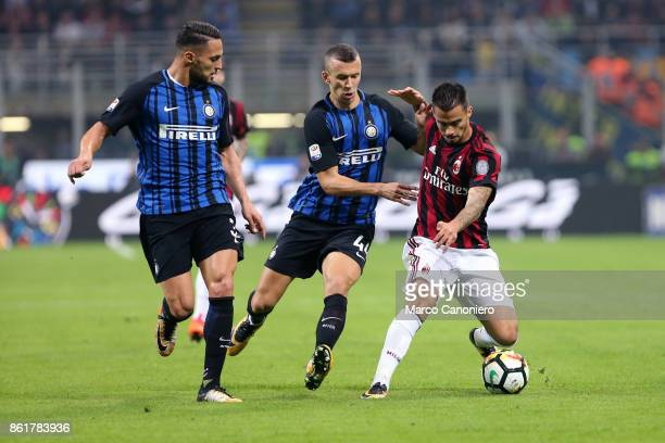 Suso of Ac Milan and Ivan Perisic of FC Internazionale in action during the Serie A football match between FC Internazionale and AC Milan Fc...
