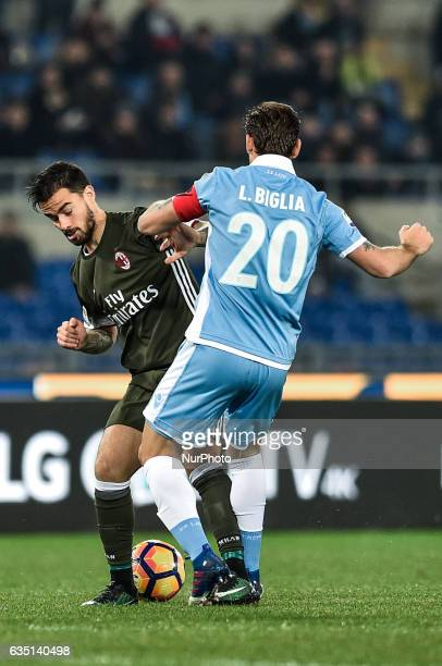 Suso of AC Milan and Lucas Biglia of Lazio fight for the ball during the Serie A match between Lazio and Milan at Stadio Olimpico Rome Italy on 13...