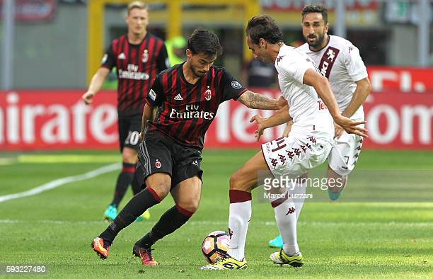 Suso of AC Milan competes for the ball with Emiliano Moretti of Torino FC during the Serie A match between AC Milan and FC Torino at Stadio Giuseppe...