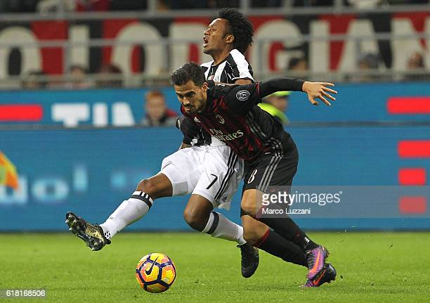 Suso of AC Milan competes for the ball with Juan Cuadrado of Juventus FC during the Serie A match between AC Milan and Juventus FC at Stadio Giuseppe...