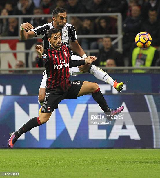 Suso of AC Milan competes for the ball with Medhi Benatia of Juventus FC during the Serie A match between AC Milan and Juventus FC at Stadio Giuseppe...