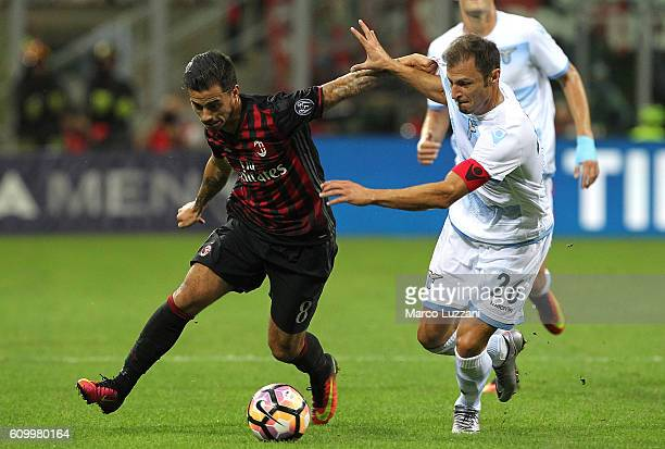 Suso of AC Milan competes for the ball with Stefan Radu of SS Lazio during the Serie A match between AC Milan and SS Lazio at Stadio Giuseppe Meazza...