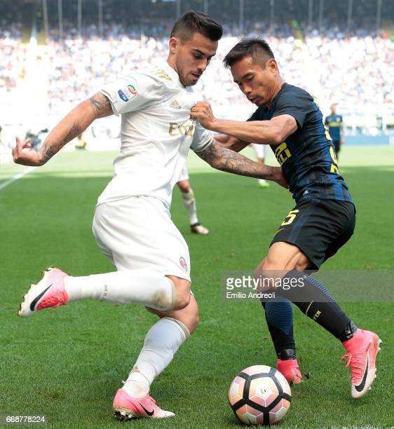 Suso of AC Milan competes for the ball with Yuto Nagatomo of FC Internazionale Milano during the Serie A match between FC Internazionale and AC Milan...