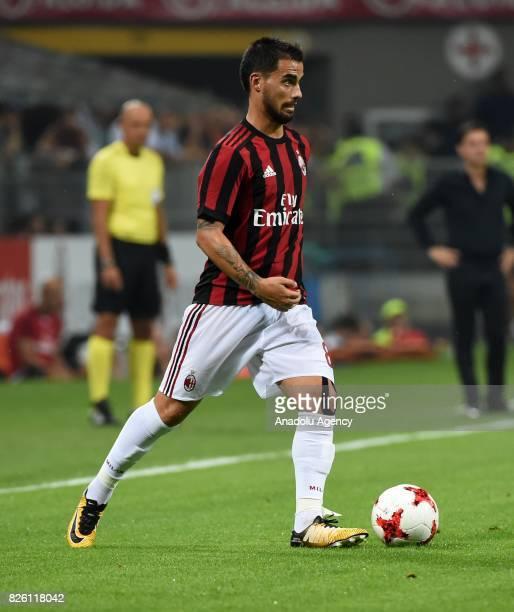 Suso of AC Milan in action against Nicusor Bancu of CS U Craiova during UEFA Europa League Qualifying Round match between AC Milan and CS U Craiova...